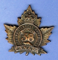 Battalion cap badge, featuring maple leaf and number 38