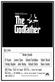The Godfather written on a black background in stylized white lettering, above it a hand holds puppet strings