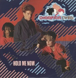 Hold Me Now (Thompson Twins song) 1983 single by Thompson Twins