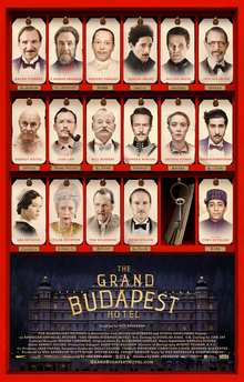 "Theatrical release poster, featuring the principal cast on a key card-hotel mailroom motif. The words ""The Grand Budapest Hotel"" are written in the foreground, superimposed on a dusk shot of the namesake building."