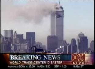 Screenshot of Cnn breaking the news about the first plane crashing into the World Trade Center on 9/11. Shows the first moments of news coverage.