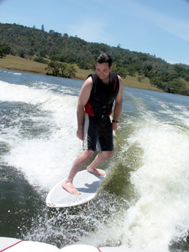 An example of someone wakesurfing.