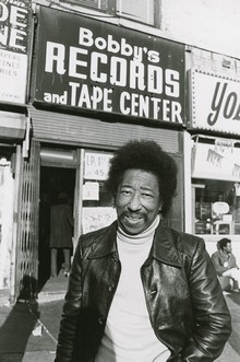 Robinson in front of his record store, 1977.