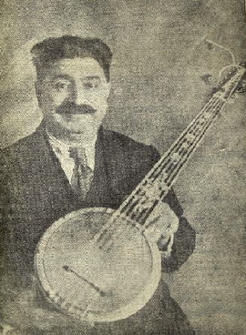 Zeynel Abidin Cümbüş holding one of the instruments he invented, from a newspaper clipping