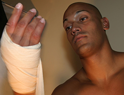 A fighter wraps his hands prior to putting gloves