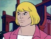 Head and shoulders of Prince Adam: a strong-looking, light-skinned man with long blond hair