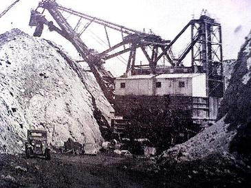 "Sahara Coal and Bucyrus-Erie's ""GEM of Egypt"" strip mine shovel, one of the largest in the world at 8 stories high and weighing 1,000 tons at Harco.[14]"