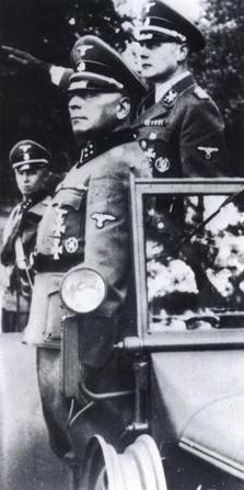 SS-Obergruppenführer Wilhelm Koppe salutes SS and German police troops