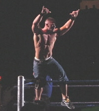 "Cena putting his hands up meaning ""Word Life""."