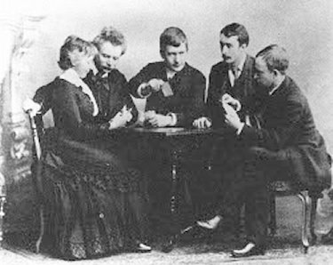 Card Party in Leipzig c. 1887 showing Nina and Edvard Grieg, Johan Halvorsen, Frederick Delius, and Christian Sinding Grieg-Delius-Leipzig 1887.jpg