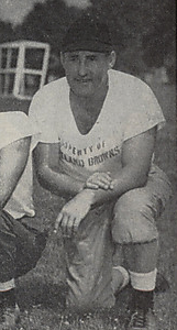 A picture of John Brickels kneeling on the grass from a 1946 Cleveland Browns game program