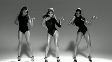 Three women are dancing. They wear similar leotards and high-heel shoes.