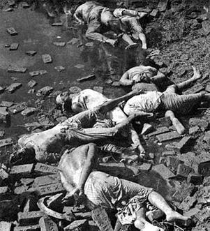 Rayerbazar killing field photographed immediately after the war, showing dead bodies of intellectuals (image courtesy: Rashid Talukder, 1971) Dead bodies of Bengali intellectuals, 14 December 1971.jpg