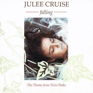 "An image of a dead woman wrapped in plastic on a white background. Brown text above reads ""Julee Cruise falling"" and below reads ""The Theme from Twin Peaks Five Inch CD single""."