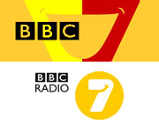 Former branding as BBC 7 (2002) and BBC Radio 7 (2008). Both featured a smiling face motif. The latter was created by design company Fallon.[3]