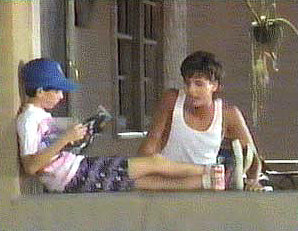 A skeptical Buddy (Josh Tygiel, left) tries to ignore Ted (David Lascher) and his scheming