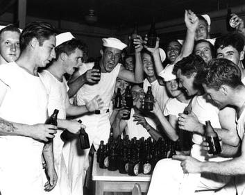 Sailors at NAS Beaufort celebrating VJ Day with Ballantine Beer