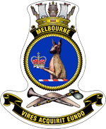 "A ship's badge. A naval crown sits on top of a black scroll with ""MELBOURNE"" written in gold. This is atop a yellow, rope-patterned ring, in which the head and torso of a kangaroo, holding a crown, is depicted. Below the ring are a stone axe and a nulla nulla sitting on top of a boomerang. At the bottom of the badge is a black scroll with ""VIRES ACQUIRIT EUNDO"" written."