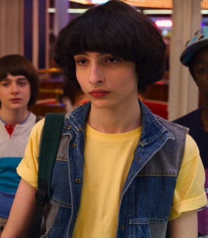 "An image of the character Mike Wheeler (portrayed by Finn Wolfhard) from season 3 of the Netflix series ""Stranger Things"".png"