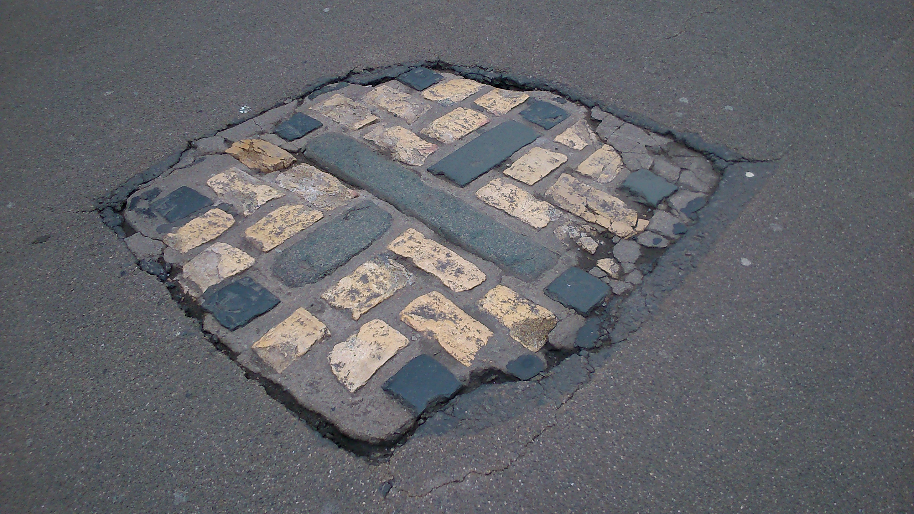 The Sunken Cobbled Cross, Marking The Location Of The Martyrs' Execution At  The Western End Of Broad Street
