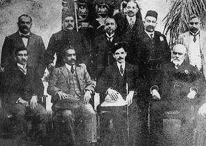 Muhammad Ali Jinnah, seated, third from the left, was a supporter of the Lucknow Pact, which, in 1916, ended the three-way rift between the Extremists, the Moderates and the League Jinnah lucknow pact1916.jpg