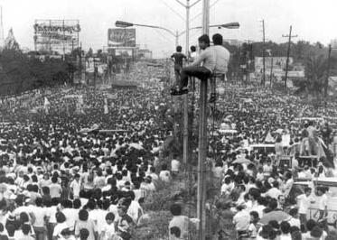 During the height of the revolution, an estimated three hundred to five hundred thousand people filled EDSA from Ortigas Avenue all the way to Cubao. The photo above shows the area at the intersection of EDSA and Boni Serrano Avenue, just between Camp Crame and Camp Aguinaldo. EDSA Revolution pic1.jpg