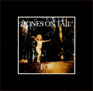 """A black background with a small square photo in the middle of a naked young girl standing on a log in a forest with the words """"TONES ON TAIL"""" and """"POP"""" above and below her, respectively, in white capital letters"""