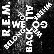 "A black background with ""R.E.M."" written in white along the left side and ""WE / TO / ALL / WHERE / GO / WE / BACK / BELONG"" written in white in a starburst design, clockwise from left-to-right"
