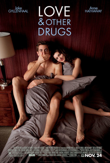 "Jamie (Jake Gyllenhaal) and Maggie (Michelle Meyer) are in torn blankets in bed, as information is below and ""Love & Other Drugs"" is at the top."