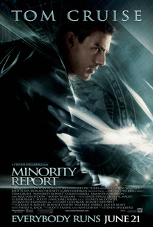 "A man wearing a leather jacket stands in a running pose. A flag with the PreCrime insignia stands in the background; the image has a blue tint. Tom Cruise's name stands atop the poster, and the title, credits, and tagline ""Everybody Runs June 21"" are on the bottom."