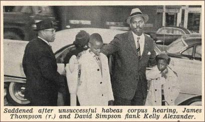 The young boys James Thompson and David Simpson with Kelly Alexander of the NAACP in Wadesboro, North Carolina in January 1959.
