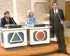 Seen here in 1975, Gene Rayburn greets two contestants and several million Americans.