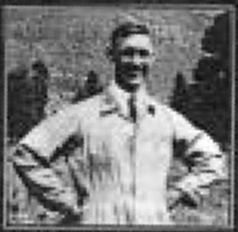Blurred, half-length portrait of a smiling man, standing with his hands on his hips