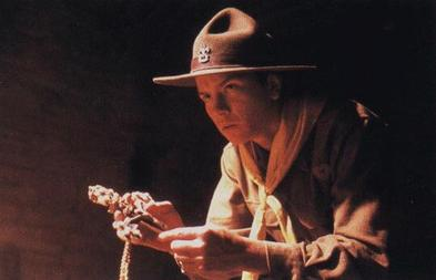 "Beginning his life of adventure: Young Indiana Jones (River Phoenix) finding the ""Cross of Coronado"" in Indiana Jones and the Last Crusade, as a Life Scout in the scene when he ""discovers his life's mission"", said film critic Roger Ebert Indiana Jones and the Cross of Coronado.jpg"