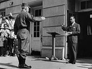 General Henry Graham salutes and then confronts George Wallace.