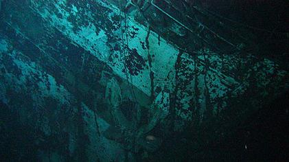 The bow of the Centaur wreck. The starboard anchor (centre), and the remains of the Red Cross identification number (above the anchor) can be seen. Centaur wreck bow.jpg