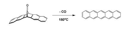 Formation of pentacene by extrusion of carbon monoxide
