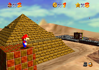 Super Mario 64 (1996) replaced the linear obstacle courses of traditional platform games with vast worlds. Mario 64 Shifting Sand Land.png