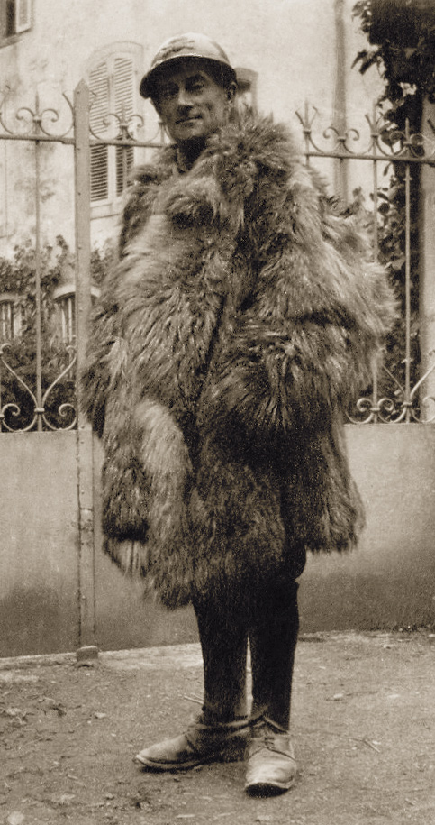 mmiddle aged man in French military uniform wrapped up in fur overcoat