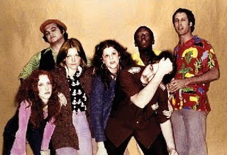 The original 1975 cast, from left to right: Laraine Newman, John Belushi, Jane Curtin, Gilda Radner, Dan Aykroyd, Garrett Morris, and Chevy Chase SNL Original Cast.jpg