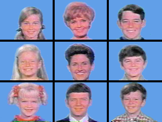 A 3 × 3 grid of squares with face shots of all nine starring characters of the television series: three blond girls in the left three squares, three brown-haired boys in the right three squares, and the middle three squares feature a blond motherly woman, a dark-haired woman, and a brown-haired man; all the faces are on blue backgrounds.