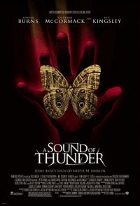 Official poster shows a red-lighted hand with a butterfly opens his wings and sits on it ,with the film cast and slogan above them ,and the film's title and credits below