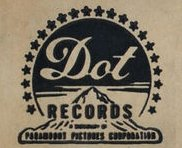 Dot Records logo after its sale to Paramount Pictures combined the original Dot script logo with the Paramount mountain and halo of stars symbol.