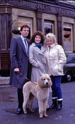 Originally introduced Wattses: Den, Angie, Sharon and Roly the poodle in the 1980s The Watts family EastEnders 1980s.jpg