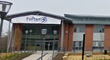 "A large brick building with a glass fronted entrance which has an apex roof; above the entrance is a sign saying ""thePoint4""; a concrete drive leads up to the building."