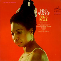 This photo of Simone on the cover of Silk & Soul (1967) is characteristic of her stage appearance in the mid-sixties