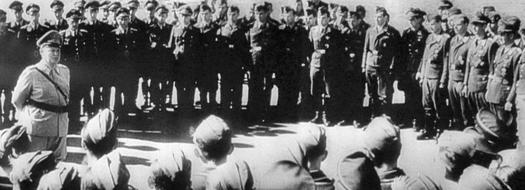 Calais, September 1940. Goring giving a speech to pilots about the change in tactics: to bomb London instead of the airfields Goering giving a speech to his fighter pilots near Calais September 1940.jpg