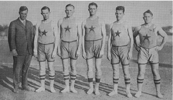 L. Theo Bellmont (left) with his undefeated 1915 Texas basketball team. 368ea0217