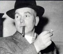 Pierrepoint, wearing a hat, and about to light a cigar