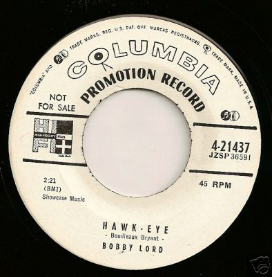 "Transitional 1955 promo 45 r.p.m. label showing both the old ""notes and mike"" and new ""walking eye"" logos Columbiatransitionallabel.jpg"